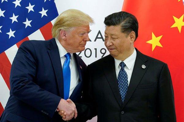 El presidente de Estados Unidos, Donald Trump (Izq.), y su homólogo chino, Xi Jinping.